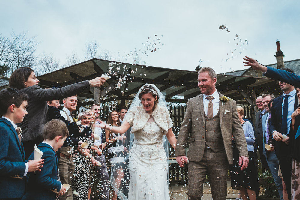 Bride and groom being showered with confetti at The Parlour at Blagdon