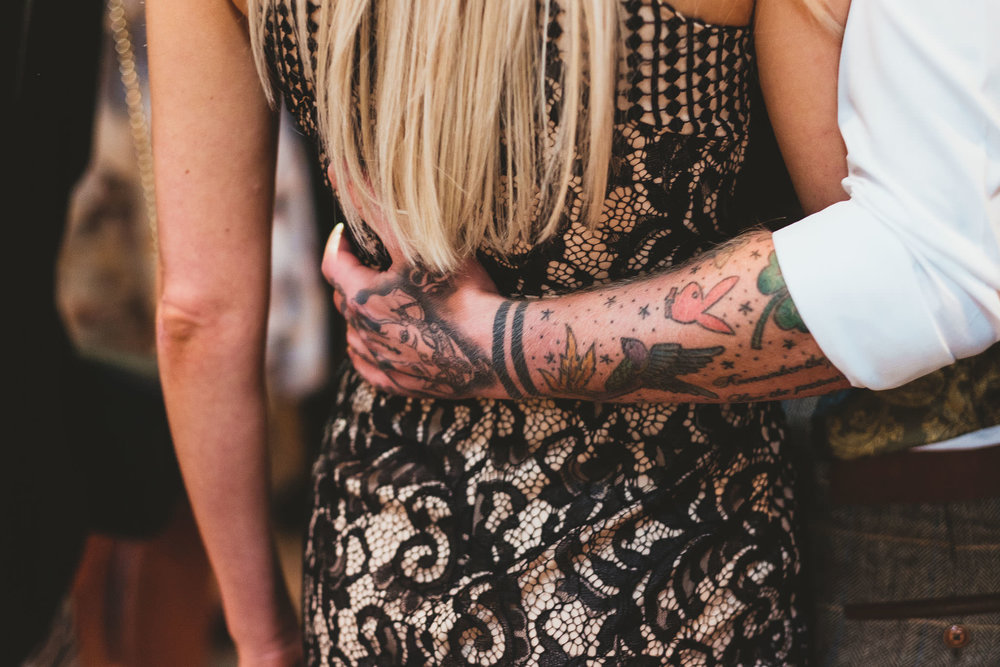 Close up of guest's tattooed arm during wedding reception