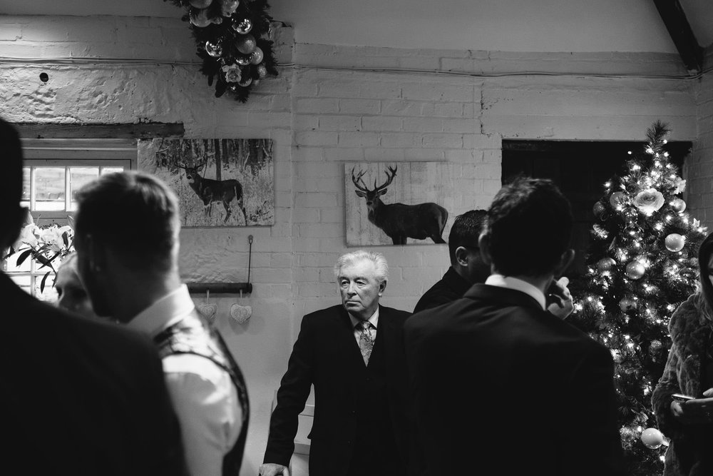 Black and white photo of older guest at wedding reception