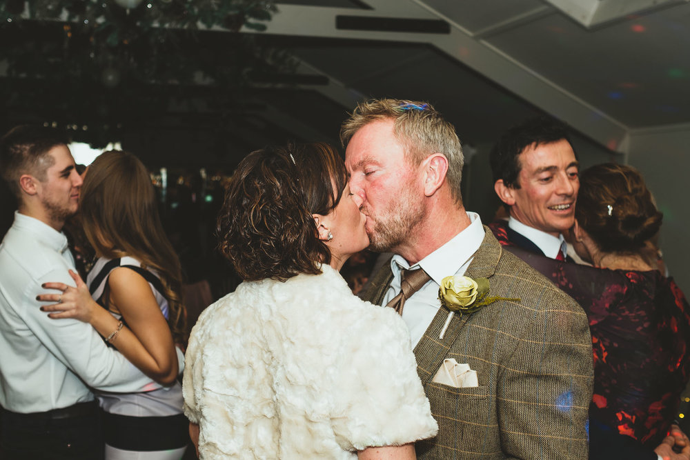 Bride and groom kiss on the dance floor at The Parlour at Blagdon