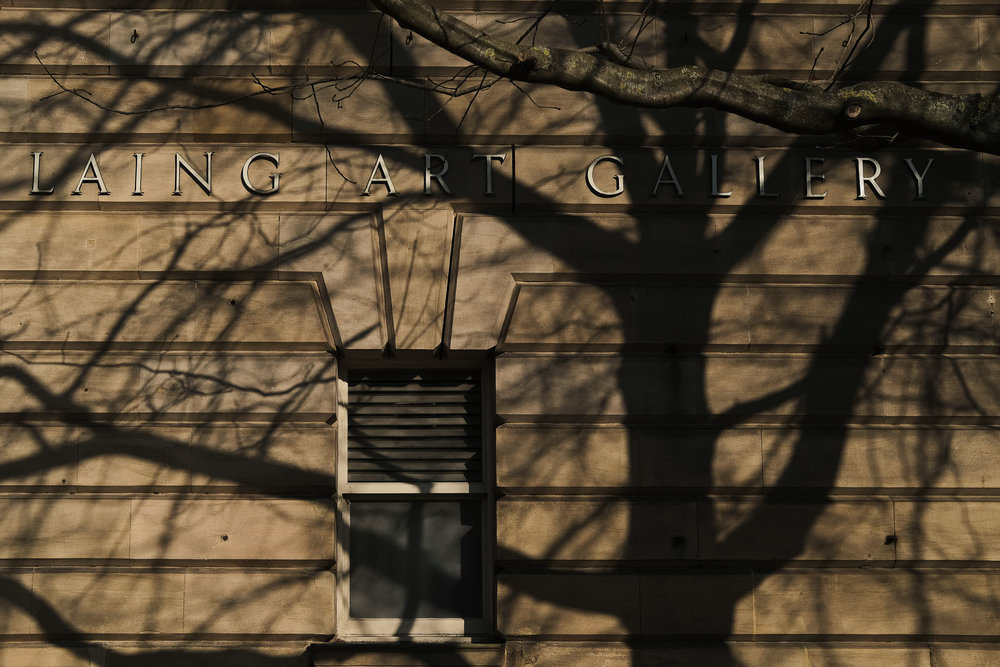 Laing Art Gallery sign covered in tree shadow