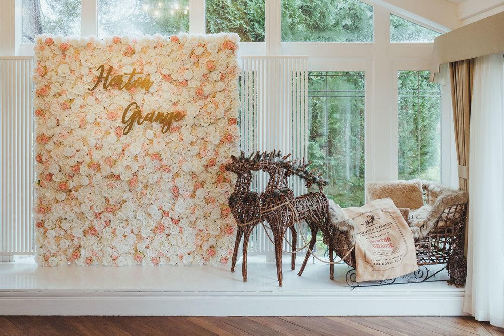 Wedding ceremony room flower wall at Horton Grange
