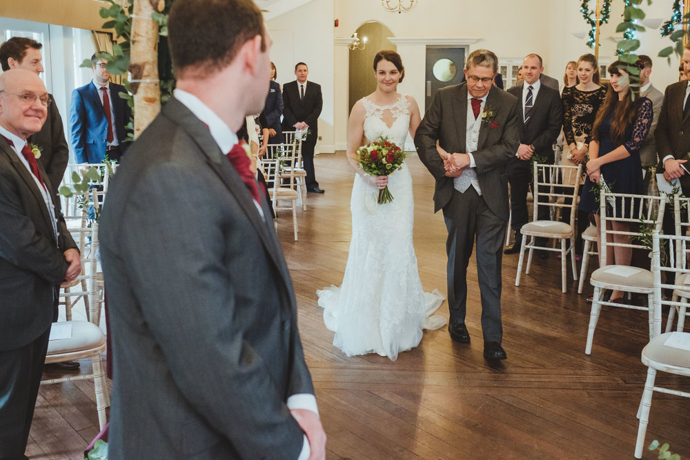 Groom watches brides entrance to wedding ceremony at Horton Grange