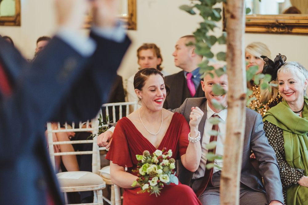 Bridesmaid pumps her fist following the wedding ceremony