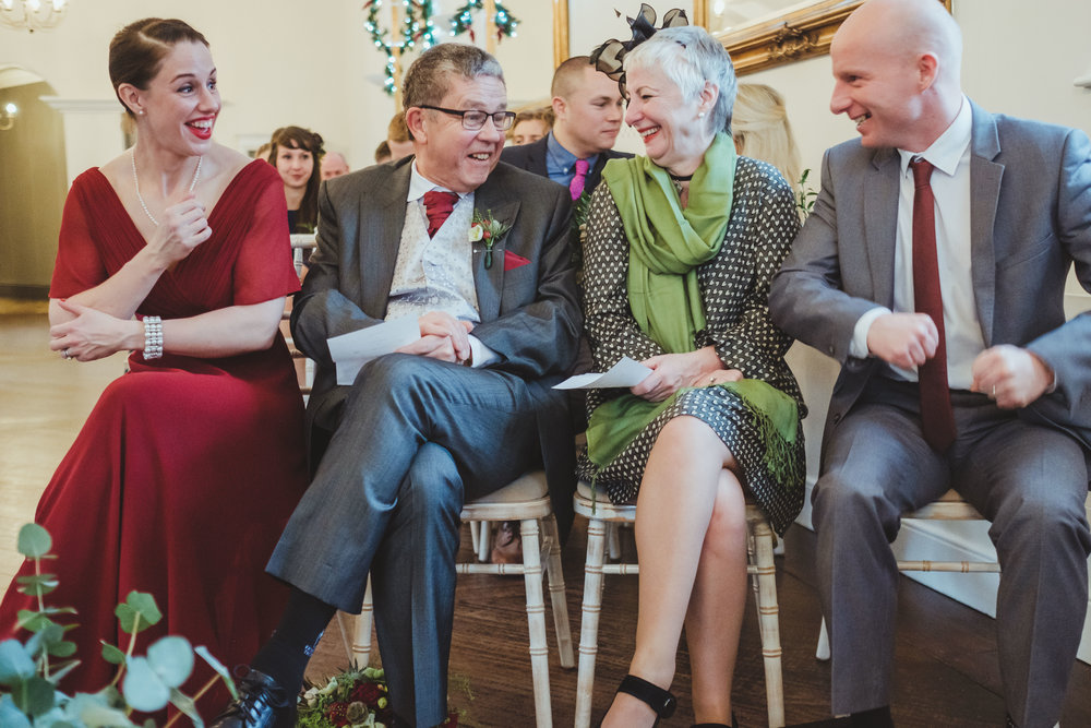 Bride's family chat and laugh following the wedding ceremony