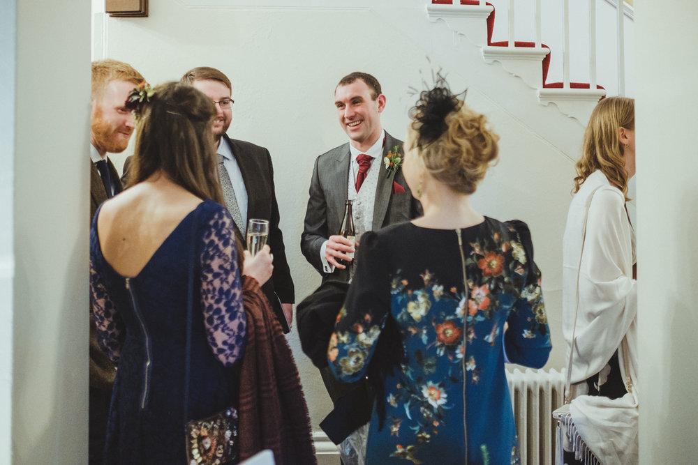 Groom receiving guests after wedding ceremony
