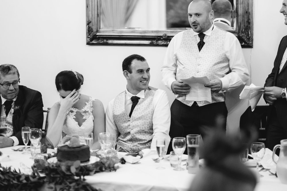 A black and white photo of the best man's speech at a wedding