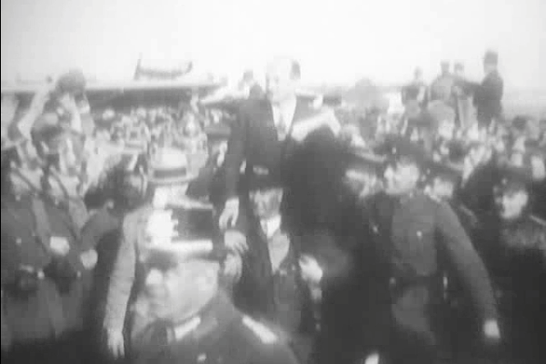 Levine held above a German crowd in a victory parade - aircraft in the background