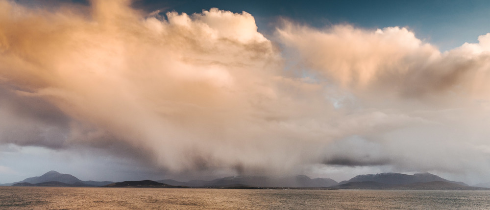 Rain showers sweeping off the Atlantic ocean downpour over the Connemara mountains.