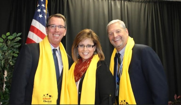 A picture in the Yellow Scarves with Principal, Lis Richard and Director, Don Griffin.