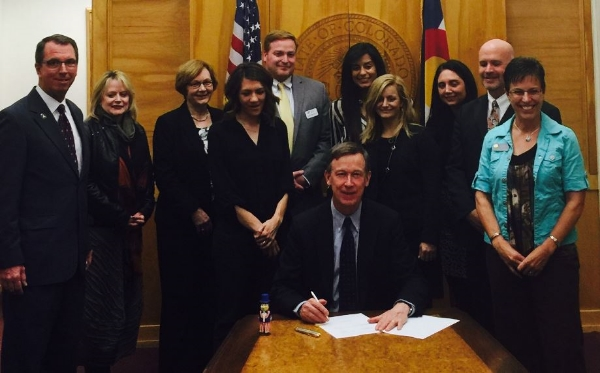 Gov. Hickenlooper signs HB16-1224 with Aggorney General Coffman, Colorado Dept. of Human Services (CDHS), Colorado Coalition Against Sexual Assault (CCASA) and Sen. Laura Woods (R) and myself (L) in attendance.