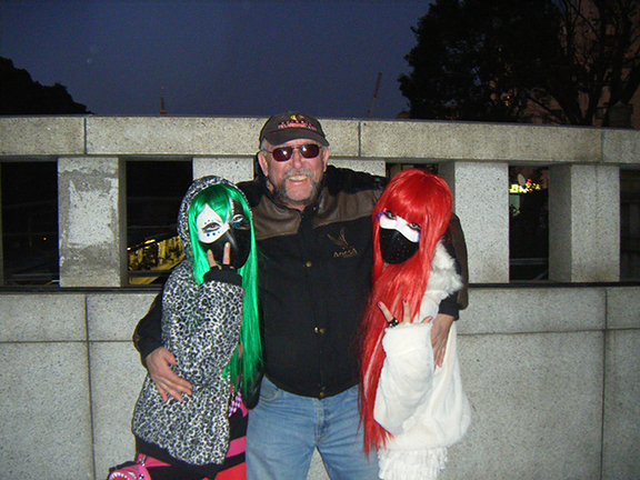 My dad with two Harajuku girls in Tokyo (2009).