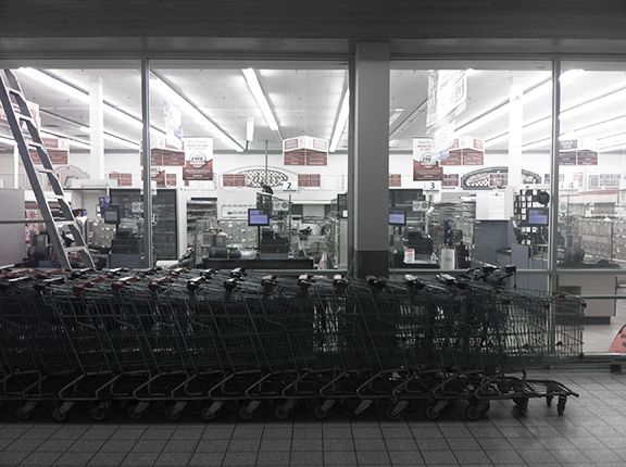 Empty shelves of a recently closed Safeway  (©Deborah Clague)
