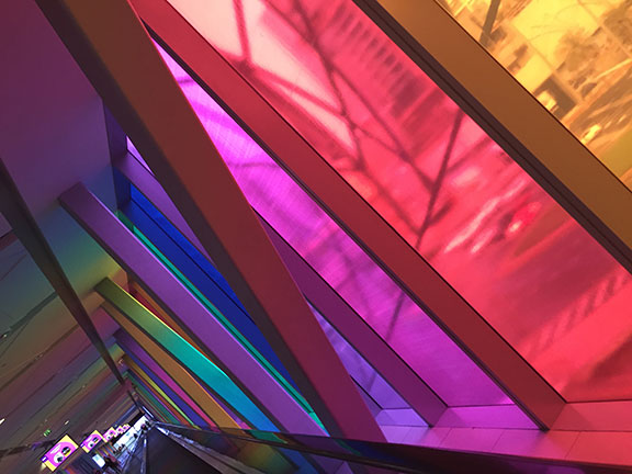 Multi-coloured panels illuminate a portion of the long - L-O-N-G - walkway into Dubai Mall (©Deborah Clague, 2016).
