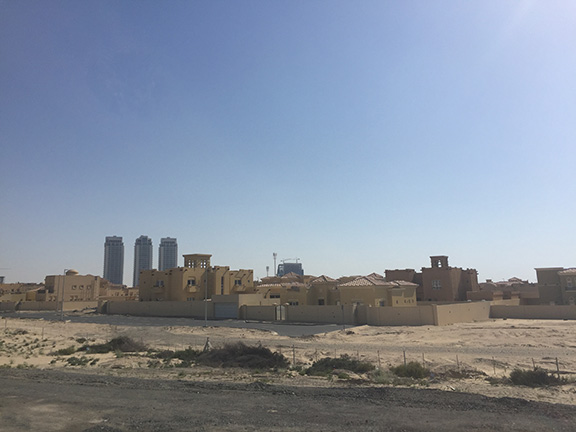 Driving out to Global Market, which lies on the edge of Dubai, we passed many neighbourhood filled with desert mansions (©Deborah Clague, 2016).