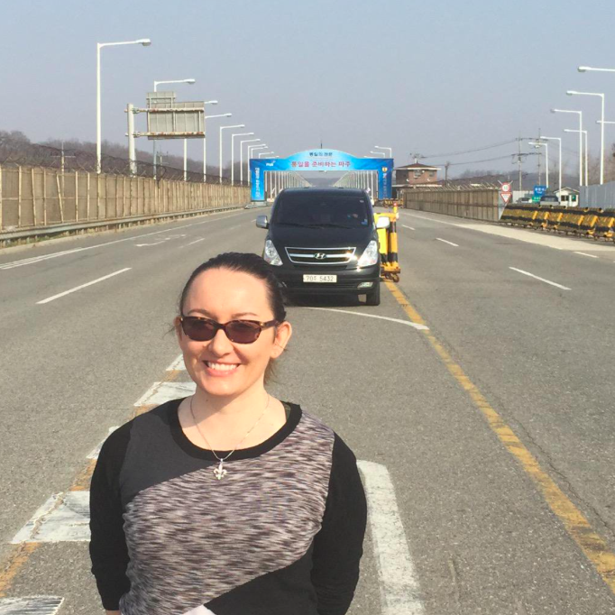 Standing on the roadway that leads to the North Korean border (©Deborah Clague)