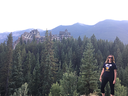 Hiking near Bow Falls with the iconic Banff Springs Hotel in the background.