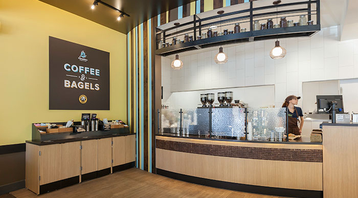 The interior of a Caribou Coffee & Einstein Bros Bagels location  |  Caribou Coffee