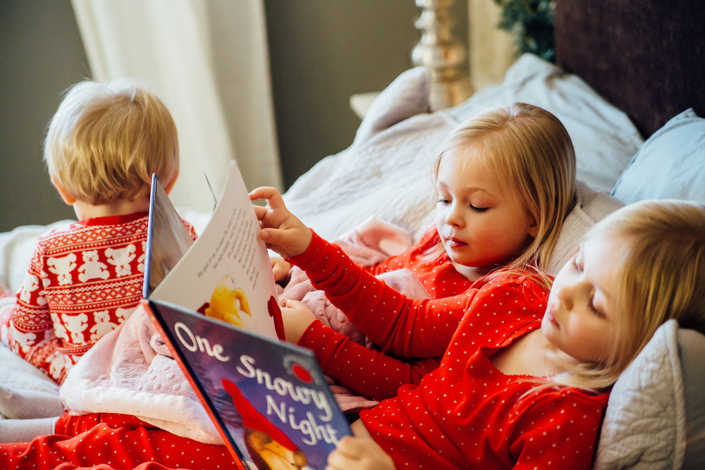 kids reading Christmas stories at candid photo session