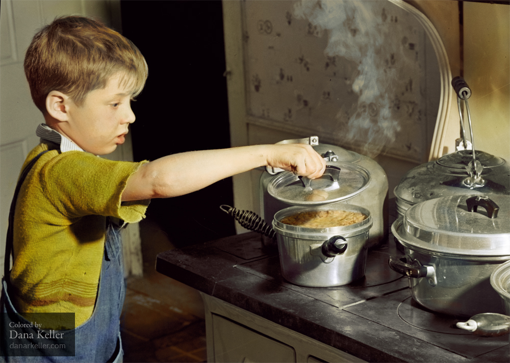 """One of the Crouch children looking to see if the """"pudd'n"""" is ready for their Thanksgiving dinner. Ledyard, Connecticut, 1940"""