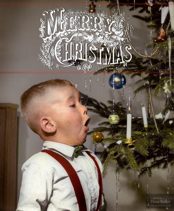 Boy Blowing Out Christmas Tree Candle