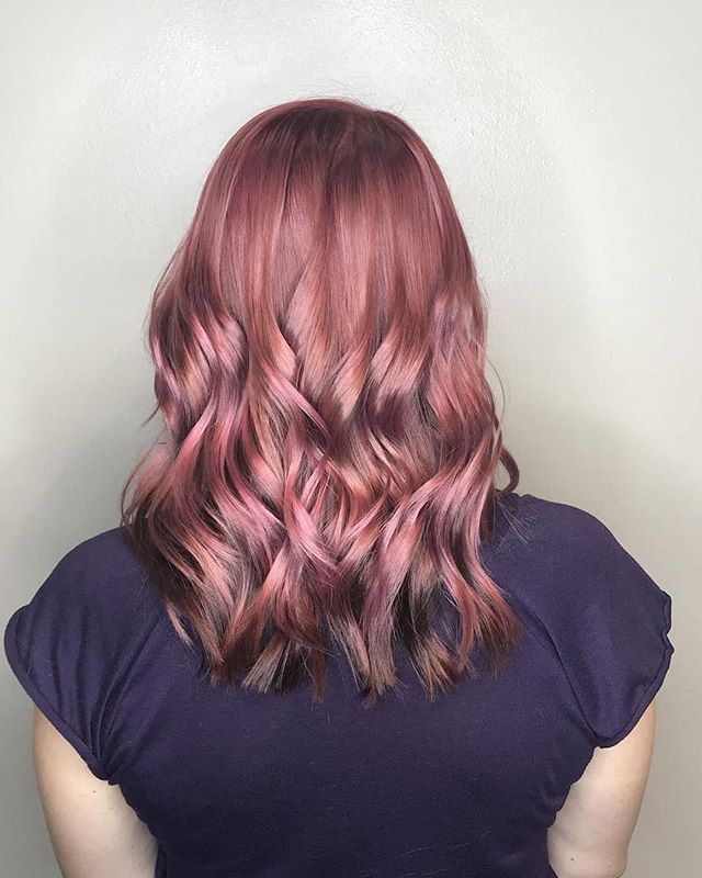 You can't resist this pretty Auburn Pink.  Hair by: @grandstyle9 🌸🌺