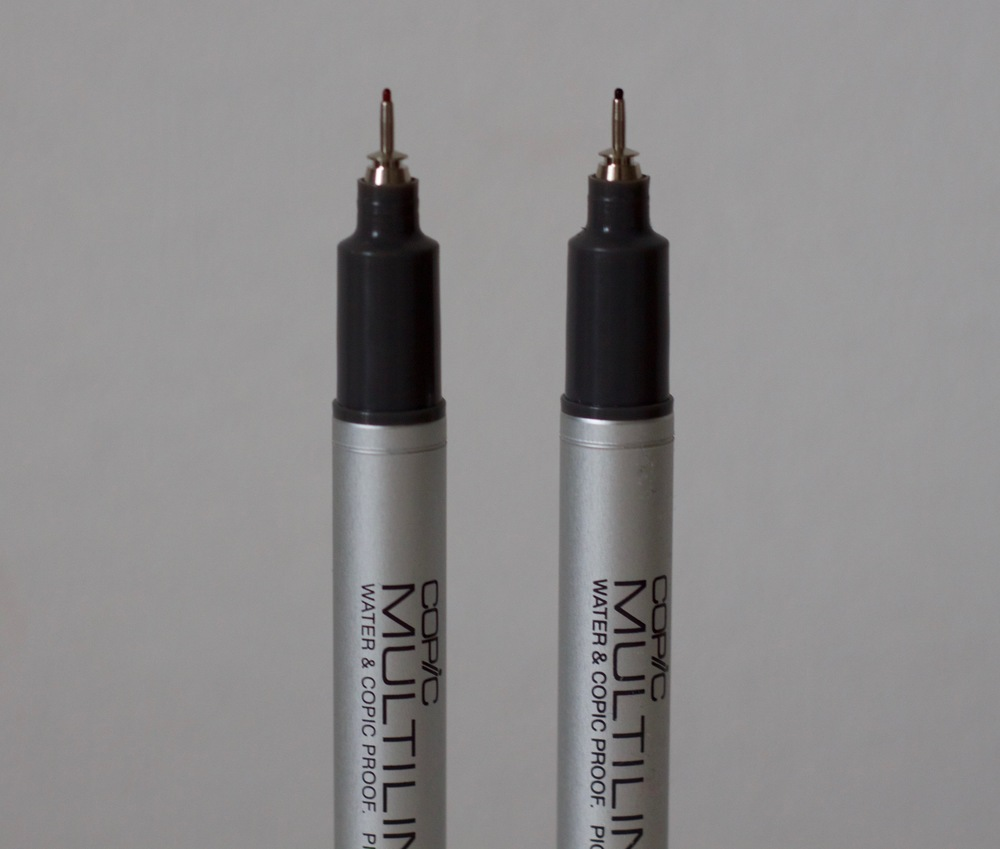 Sepia Copic Multiliner on the left and Black Copic Multiliner on the right