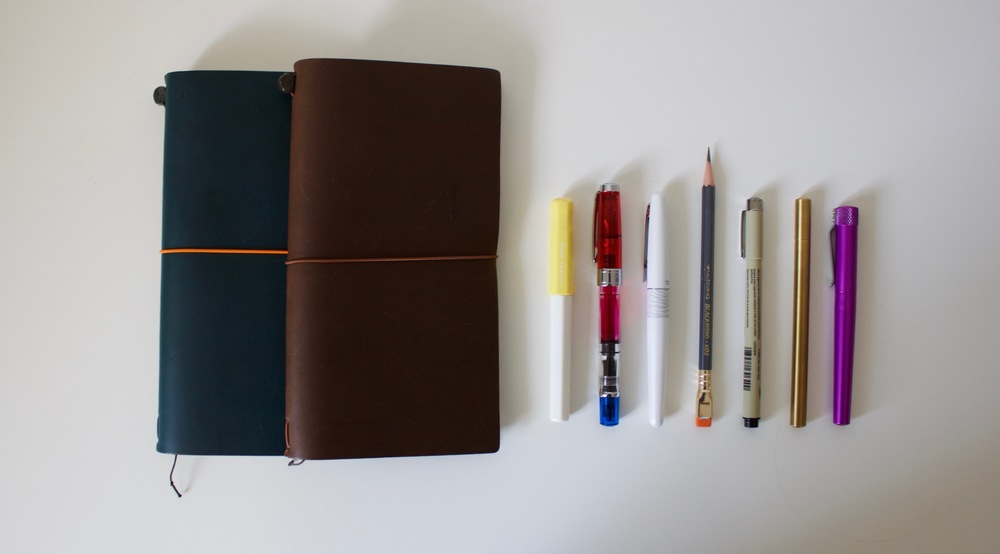 My two Midori Travelers Notebooks and an array of pens