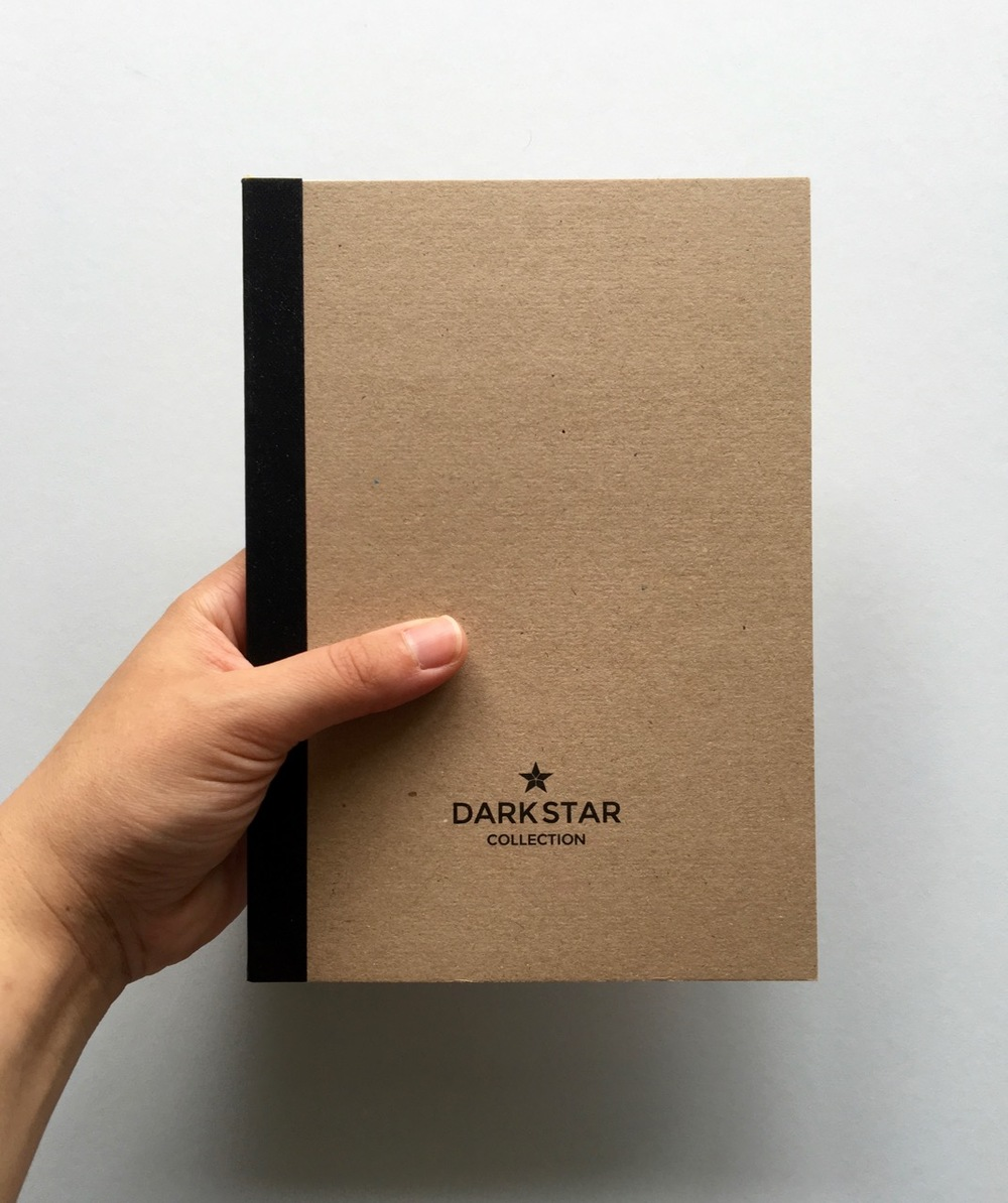 The Dark Star Collection Notebook in hand