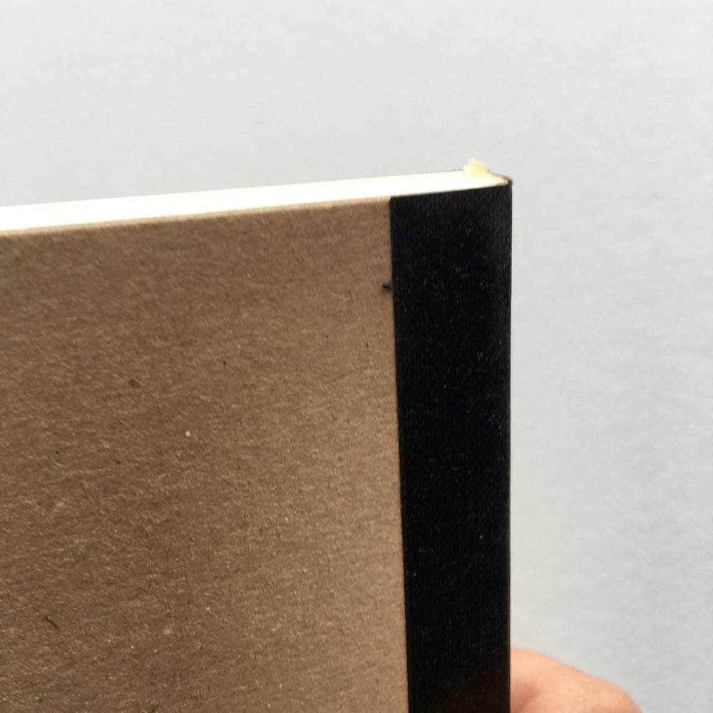 Close up of the binding and glue holding the pages together. I think the excess glue here, which is coming away may be the source of my page problem