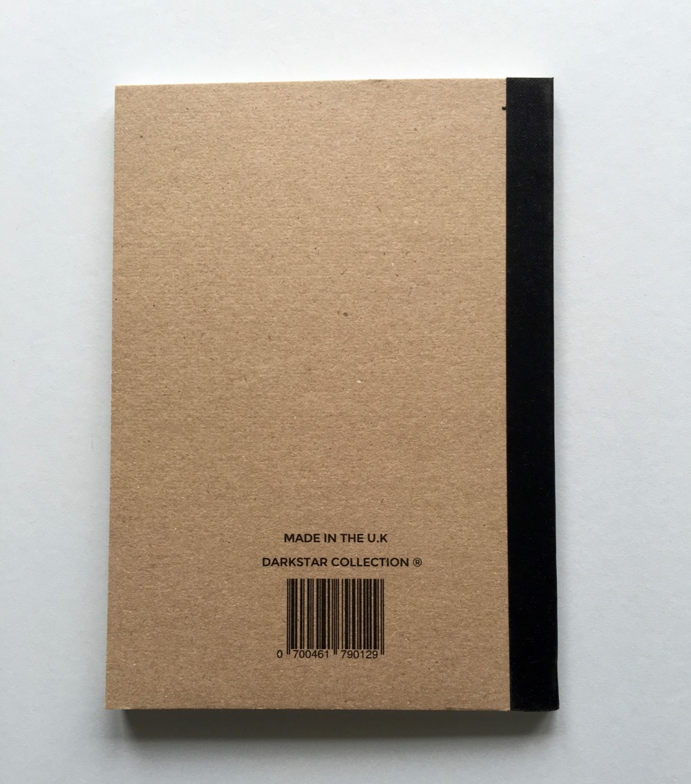 The reverse of the notebook. Unfortunately the branding and information on the back has not been aligned with the binding width taken into consideration.
