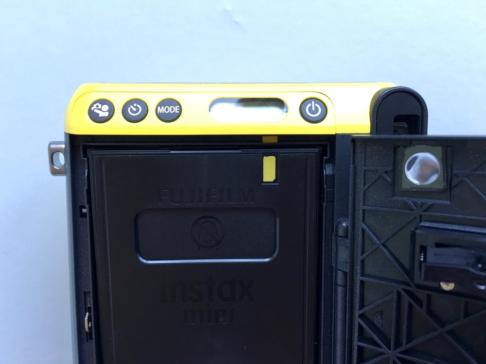 Film cartridge with helpful yellow guides to assist with correct loading