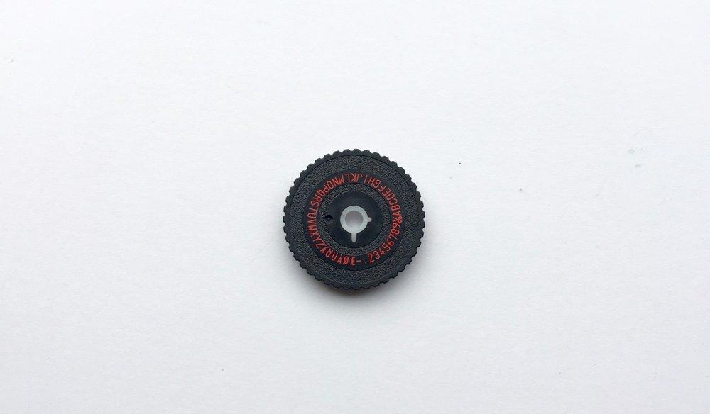 The secondary upper case type wheel
