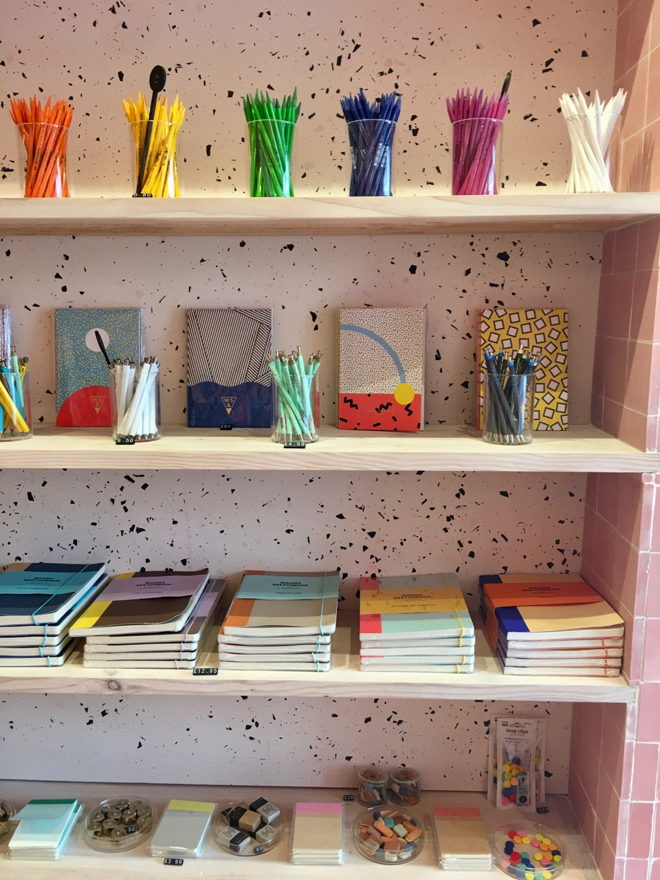 A wall of pencils, notebooks and accessories