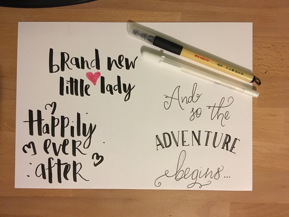 Practicing brush lettering styles for a New Baby card.