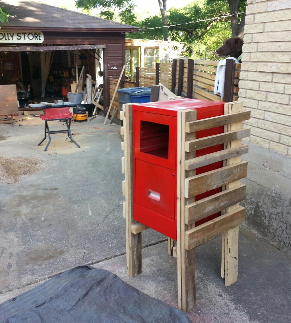 The little free library/red cabinet housing under construction.