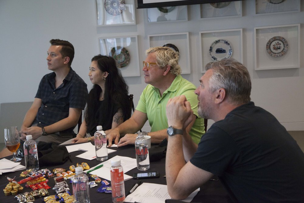 Outsiders Jeff Boyum, Lilian Kao, and Kent Mendenhall sit with Jim Garland of Fluidity Design. All photos by Arlen Kennedy.