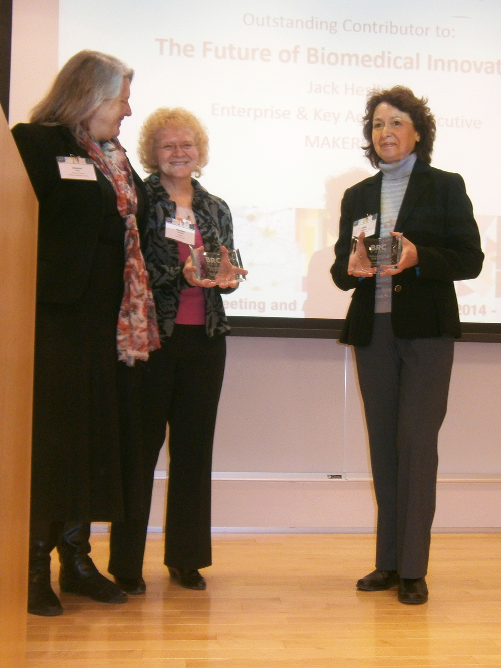 Dr. Dolly Koltchev receiving award.