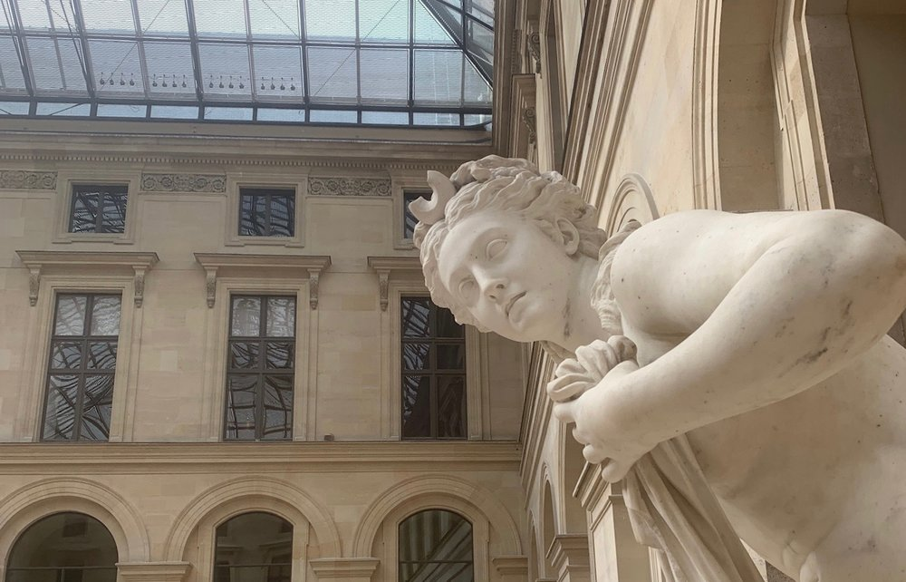 Installation of Roman statues at the Louvre
