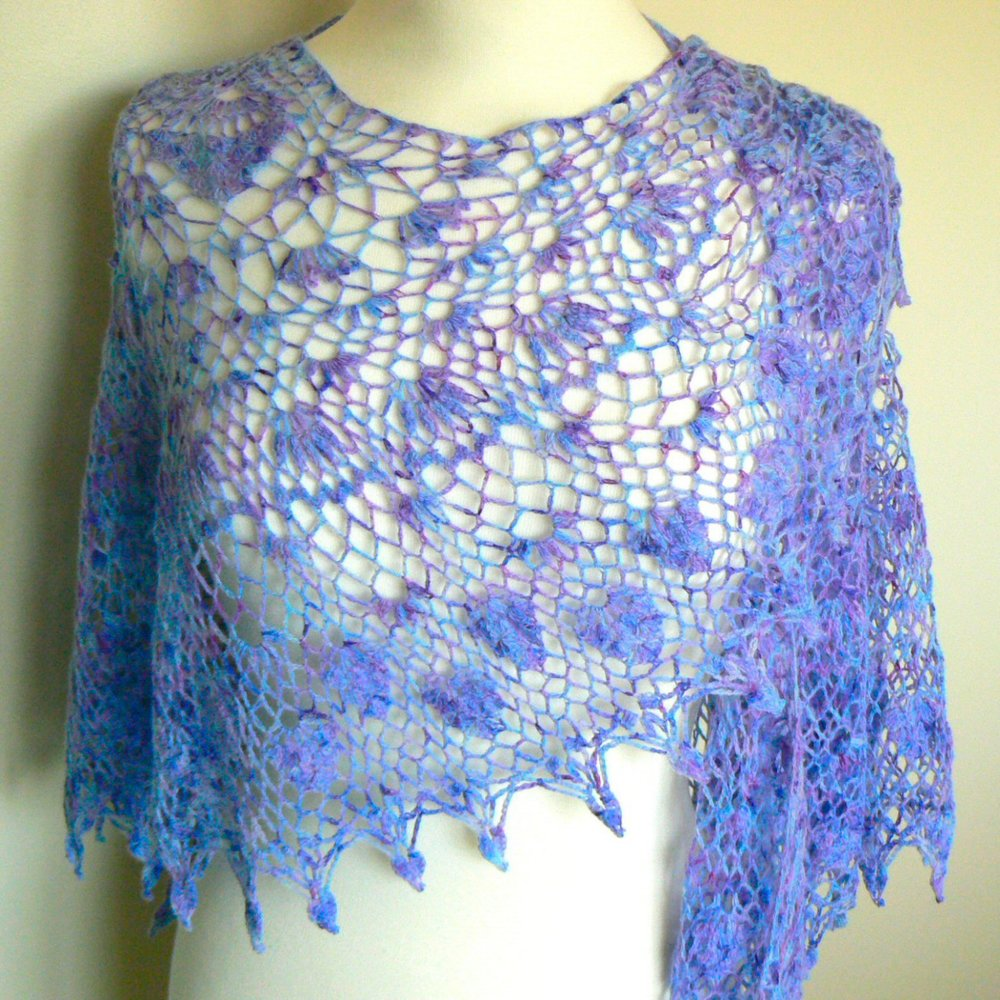 Watercolours and Lace: Our latest shawl design - and first in crochet - is Irene. Featuring a variety of lace patterns and a decorative edging, it can be made in any of our standard or fine lace yarns.