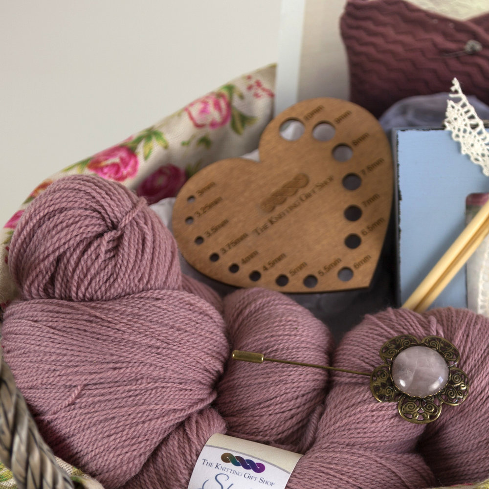 The Knitting Gift Shop   Original design knitting patterns and kits using their own range of natural wool from fleece sourced and spun in the UK. Wooden yarn bowls, yarn servers, swifts, shawl pins and accessories. Unique knitting themed gifts