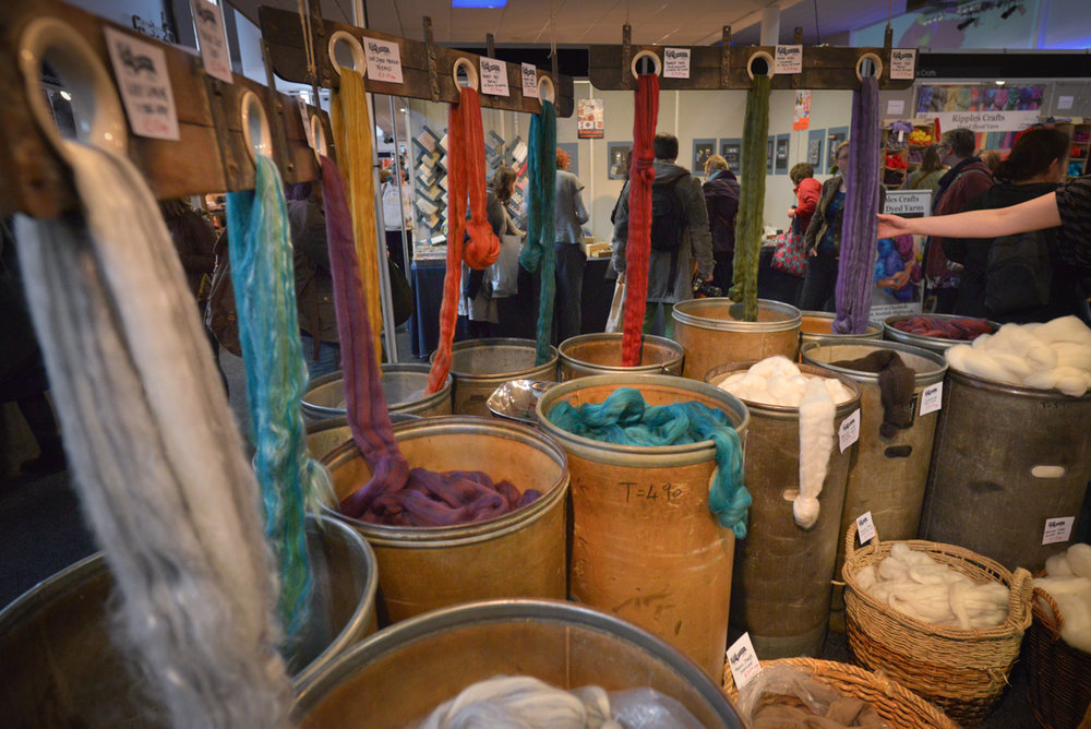 John Arbon Textiles will have a stand in the main marketplace from Thursday to Saturday.  (Look for tubs of fibre and a wall of yarn!) You will also be able to find them in the Concourse on Sunday as part of Make:Wool.