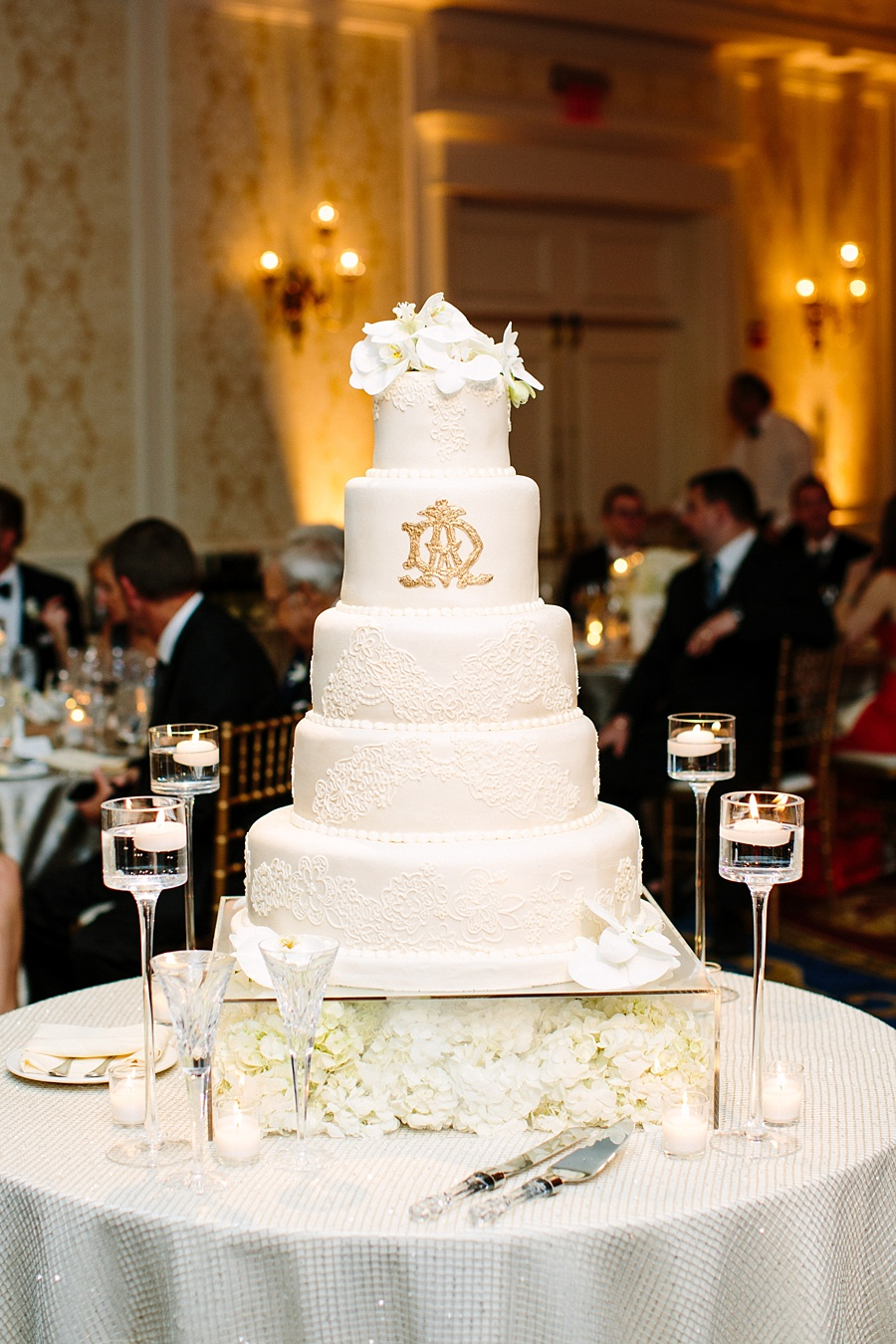 All white wedding cake with gold monogram | Edible Art Bakery of Raleigh