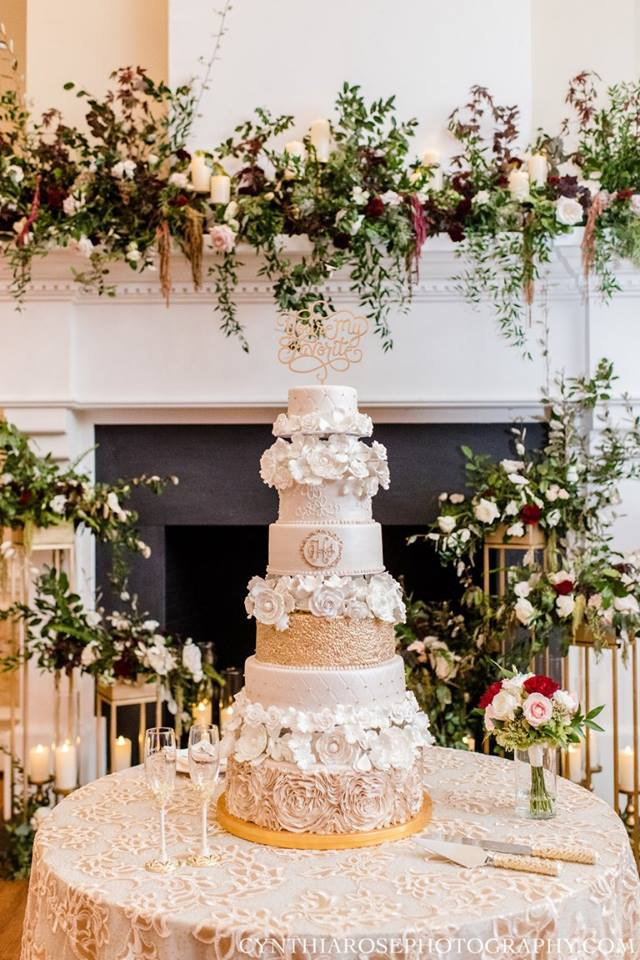 Wedding cake with flower fireplace | Edible Art Bakery of Raleigh