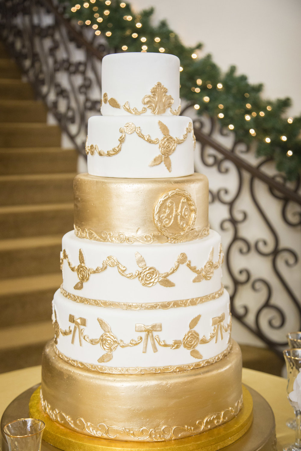 White and Gold Tiered Wedding Cake | Edible Art Bakery of Raleigh