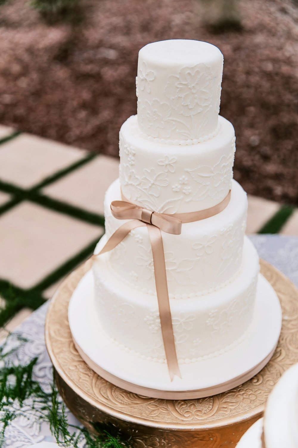 All white fondant wedding cake | Edible Art Bakery of Raleigh