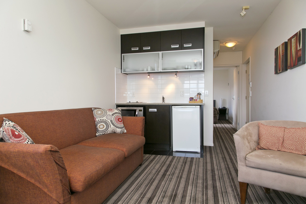one bedroom lake view lounge kitchenette towards bedroom.jpg