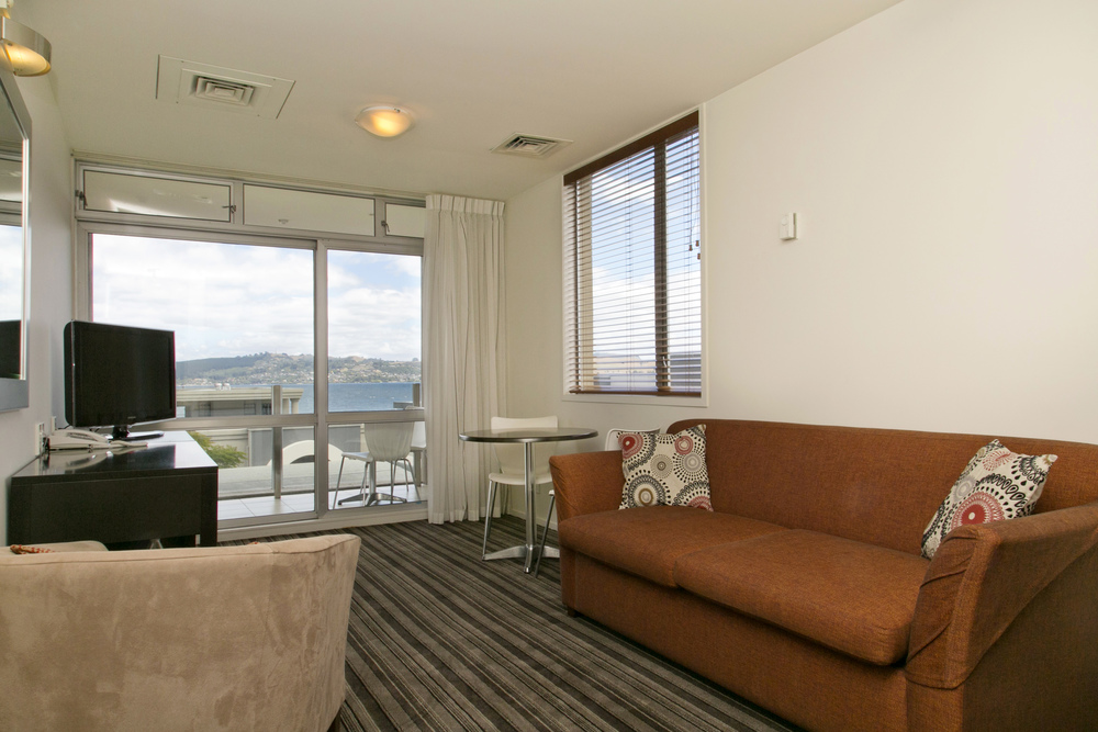 one bedroom lake view lounge towards balcony.jpg