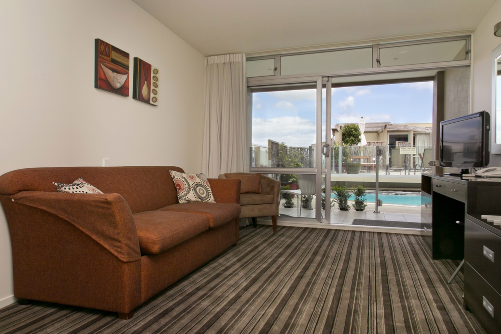 one bedroom poolside lounge towards pool area.jpg