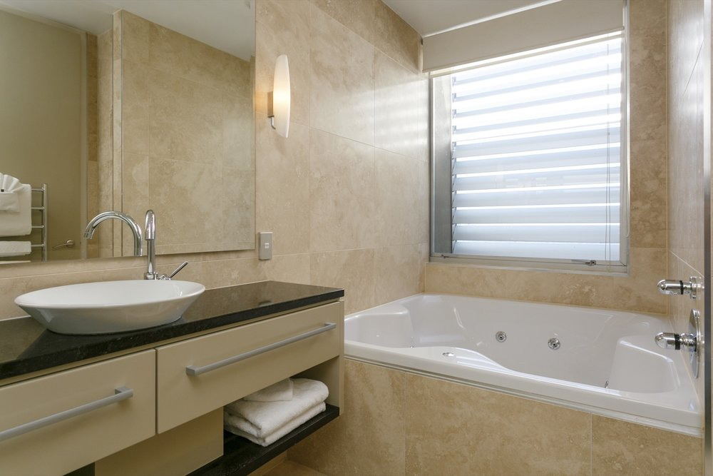 First floor three bedroom apartment master bedroom ensuite bathroom with spa bath 2.jpg